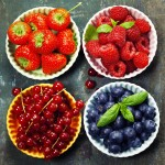 Fresh Berries on Wooden Background. Strawberries, Raspberries and Blueberries. Health, Diet, Gardening, Harvest Concept