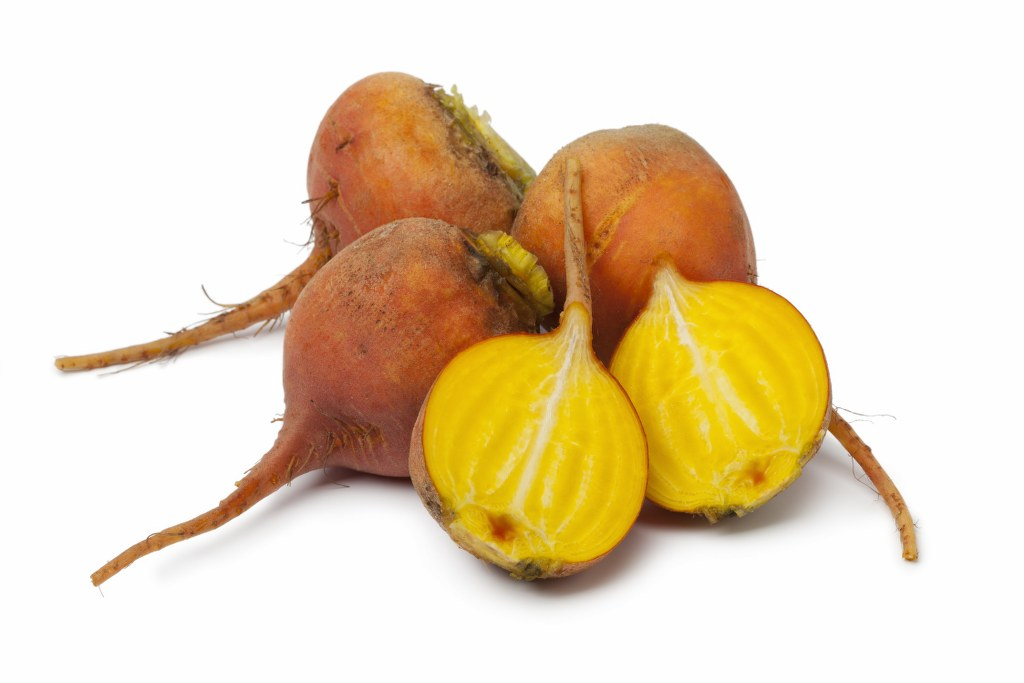 Yellow beets on white background